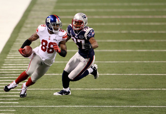 INDIANAPOLIS, IN - FEBRUARY 05:  Hakeem Nicks #88 of the New York Giants runs with the ball against Antwaun Molden #27 of the New England Patriots  during Super Bowl XLVI at Lucas Oil Stadium on February 5, 2012 in Indianapolis, Indiana.  (Photo by Jeff G