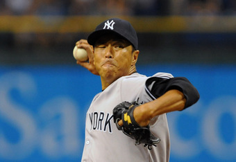 ST. PETERSBURG, FL - APRIL 7: Pitcher Hiroki Kuroda #18 of the New York Yankees starts against the Tampa Bay Rays April 7, 2012  at Tropicana Field in St. Petersburg, Florida.  (Photo by Al Messerschmidt/Getty Images)