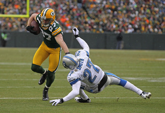 GREEN BAY, WI - JANUARY 01: Jordy Nelson #87 of the Green Bay Packers stiff-arms Alphonso Smith #27 of the Detroit Lions on his way to scoring a touchdown at Lambeau Field on January 1, 2012 in Green Bay, Wisconsin. (Photo by Jonathan Daniel/Getty Images)