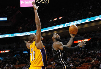 MIAMI, FL - JANUARY 19:  LeBron James #6 of the Miami Heat drives against Andrew Bynum #17 of the Los Angeles Lakers during a game  at American Airlines Arena on January 19, 2012 in Miami, Florida. NOTE TO USER: User expressly acknowledges and agrees that