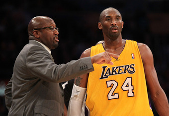 LOS ANGELES, CA - DECEMBER 27:  Kobe Bryant #24 of the Los Angeles Lakers confers with head coach Mike Brown during the game against the Utah Jazz at Staples Center on December 27, 2011 in Los Angeles, California.  The Lakers won 96-71. NOTE TO USER: User