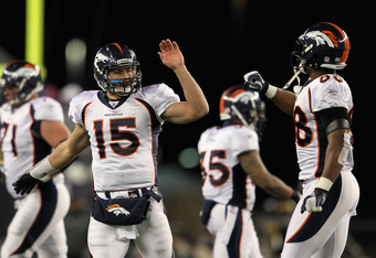 FOXBORO, MA - JANUARY 14:  (L-R) Tim Tebow #15 of the Denver Broncos celebrates a play with Demaryius Thomas #88 against the New England Patriots during their AFC Divisional Playoff Game at Gillette Stadium on January 14, 2012 in Foxboro, Massachusetts.