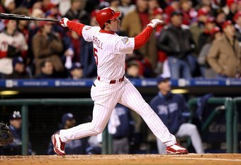 PHILADELPHIA - OCTOBER 29:  Pat Burrell #5 of the Philadelphia Phillies hits a double in the top of the seventh inning against the Tampa Bay Rays during the continuation of game five of the 2008 MLB World Series on October 29, 2008 at Citizens Bank Park i