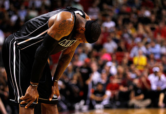 MIAMI, FL - APRIL 10: LeBron James #6 of the Miami Heat reacts to a foul during a game against the Boston Celtics at American Airlines Arena on April 10, 2012 in Miami, Florida. NOTE TO USER: User expressly acknowledges and agrees that, by downloading and