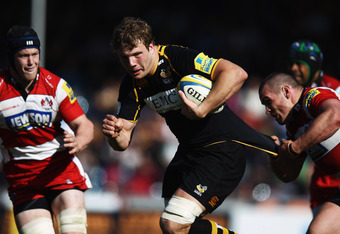 HIGH WYCOMBE, ENGLAND - APRIL 01:  Joe Launchbury of London Wasps is tackled by Dan Murphy of Gloucester Rugby during the Aviva Premiership match between London Wasps and Gloucester at Adams Park on April 1, 2012 in High Wycombe, England.  (Photo by Bryn