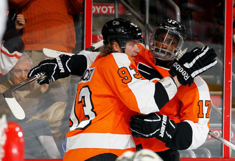 PHILADELPHIA, PA - FEBRUARY 16:  Wayne Simmonds #17 of the Philadelphia Flyers celebrates his goal with Jakub Voracek against the Buffalo Sabres during their game on February 16, 2012 at The Wells Fargo Center in Philadelphia, Pennsylvania.  (Photo by Al
