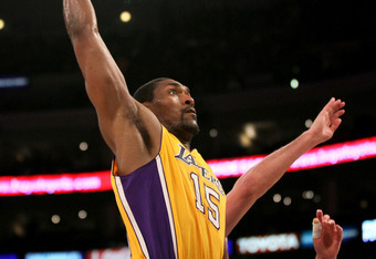 LOS ANGELES, CA - APRIL 13:  Metta World Peace #15 of the Los Angeles Lakers goes up for a dunk against the Denver Nuggets at Staples Center on April 13, 2012 in Los Angeles, California. NOTE TO USER: User expressly acknowledges and agrees that, by downlo