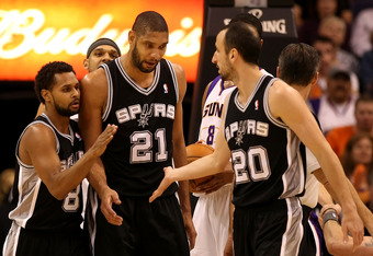 PHOENIX, AZ - MARCH 27:  (L-R) Patrick Mills  #8, Tim Duncan #21 and Manu Ginobili #20 of the San Antonio Spurs celebrate after scoring against the Phoenix Suns during the NBA game at US Airways Center on March 27, 2012 in Phoenix, Arizona.  The Spurs def