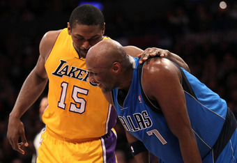 LOS ANGELES, CA - JANUARY 16:  Lamar Odom #7 of the Dallas Mavericks is greeted by Metta World Peace #15 of the Los Angeles Lakers at Staples Center on January 16, 2012 in Los Angeles, California.  NOTE TO USER: User expressly acknowledges and agrees that
