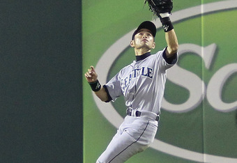 ARLINGTON, TX - APRIL 11: Ichiro Suzuki #51 of the Seattle Mariners catches a pop fly in the ninth inning hit by Yorvit Torrealba #8 of the Texas Rangers at Rangers Ballpark in Arlington on April 11, 2012 in Arlington, Texas. (Photo by Rick Yeatts/Getty I