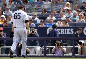 NEW YORK, NY - APRIL 14:  Phil Hughes #65 of the New York Yankees leaves the game in the fourth inning against the Los Angeles Angels of Anaheim during the home opener at Yankee Stadium on April 14, 2012 in the Bronx borough of New York City.  (Photo by N