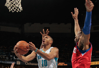 NEW ORLEANS, LA - JANUARY 04:  Eric Gordon #10 of the New Orleans Hornets makes a shot over Spencer Hawes #0 of the Philadelphia 76ers at New Orleans Arena on January 4, 2012 in New Orleans, Louisiana. NOTE TO USER: User expressly acknowledges and agrees