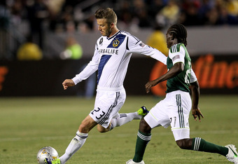 CARSON, CA - APRIL 14:  David Beckham #23 of the Los Angeles Galaxy passes the ball away from Diego Chara #21 of the Portland Timbers at The Home Depot Center on April 14, 2012 in Carson, California.  The Galaxy won 3-1.  (Photo by Stephen Dunn/Getty Imag