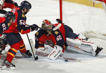 SUNRISE, FL - APRIL 13: Goaltender Jose Theodore #60 of the Florida Panthers stops a third period shot by the New Jersey Devils in Game One of the Eastern Conference Quarterfinals during the 2012 NHL Stanley Cup Playoffs at the BankAtlantic Center on Apri
