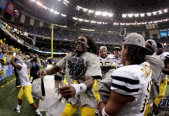 NEW ORLEANS, LA - JANUARY 03:  Denard Robinson #16 of the Michigan Wolverines celebrates with his teammates after Michigan won 23-20 in overtime against the Virginia Tech Hokies during the Allstate Sugar Bowl at Mercedes-Benz Superdome on January 3, 2012