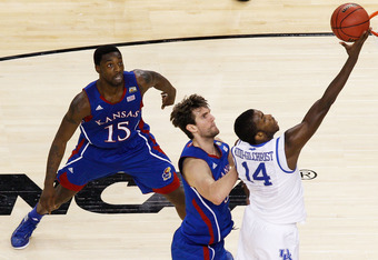 NEW ORLEANS, LA - APRIL 02:  Michael Kidd-Gilchrist #14 of the Kentucky Wildcats lays the ball up in front of Jeff Withey #5 of the Kansas Jayhawks in the first half in the National Championship Game of the 2012 NCAA Division I Men's Basketball Tournament
