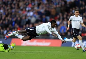 LONDON, ENGLAND - APRIL 15:  Emmanuel Adebayor of Tottenham Hotspur is brought down by Petr Cech of Chelsea before team mate Gareth Bale (R) scores their first goal during the FA Cup with Budweiser Semi Final match between Tottenham Hotspur and Chelsea at