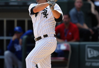 CHICAGO, IL - AUGUST 14: Paul Konerko #14 of the Chicago White Sox gets one of his three hits against the Kansas City Royals at U.S. Cellular Field on August 14, 2011 in Chicago, Illinois. The White Sox defeated the Royals 6-2. (Photo by Jonathan Daniel/G