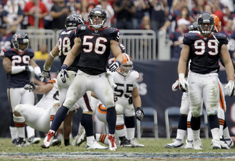 HOUSTON, TX - NOVEMBER 06: Linebacker Brian Cushing #56 of the Houston Texans celebrates after stopping the run of the Cleveland Browns on November 6, 2011 at Reliant Stadium in Houston, Texas.(Photo by Thomas B. Shea/Getty Images)