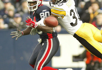 ORCHARD PARK, NY - JANUARY 2:  Chad Scott #30 of the Pittsburgh Steelers strips the ball away from Eric Moulds #80 of the Buffalo Bills January 2, 2005 at Ralph Wilson Stadium in Orchard Park, New York. The Steelers defeated the Bills 29-24, to eliminate