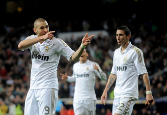 MADRID, SPAIN - APRIL 14:  Karim Benzema (L) of Real Madrid CF celebrates beside Angel di Maria after scoring his team's third goal during the La Liga match between Real Madrid CF and Real Sporting de Gijon at Estadio Santiago Bernabeu on April 14, 2012 i