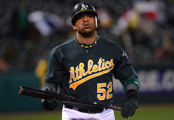 OAKLAND, CA - APRIL 10:  Yoenis Cespedes #52 of the Oakland Athletics looks on in frustation after striking out in the seventh inning against the Kansas City Royals at O.co Coliseum on April 10, 2012 in Oakland, California.  (Photo by Thearon W. Henderson