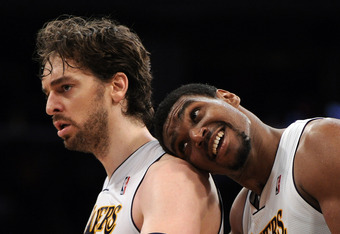 LOS ANGELES, CA - APRIL 15:  Pau Gasol #16 of the Los Angeles Lakers reacts to his three pointer with Andrew Bynum #17 against the Dallas Mavericks on way to a 112-108 win during overtime at Staples Center on April 15, 2012 in Los Angeles, California.  NO