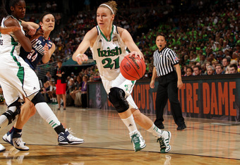 DENVER, CO - APRIL 01:  Natalie Novosel #21 of the Notre Dame Fighting Irish drives in the first half against the Connecticut Huskies during the National Semifinal game of the 2012 NCAA Division I Women's Basketball Championship at Pepsi Center on April 1