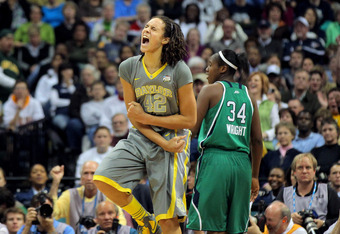 DENVER, CO - APRIL 03:  Brittney Griner #42 of the Baylor Bears celebrates late in the second half against the Notre Dame Fighting Irish during the National Final game of the 2012 NCAA Division I Women's Basketball Championship at Pepsi Center on April 3,