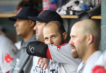 DETROIT, MI - APRIL 07:  Dustin Pedroia #15 of the Boston Red Sox watches the action from the dugout during the game against the Detroit Tigers at Comerica Park on April 7, 2012 in Detroit, Michigan. The Tigers defeated the Red Sox 10-0.  (Photo by Leon H