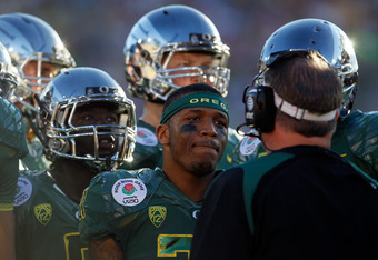 PASADENA, CA - JANUARY 02:  Running back LaMichael James #21 of the Oregon Ducks looks at his head coach Chip Kelly as the Ducks take on the Wisconsin Badgers at the 98th Rose Bowl Game on January 2, 2012 in Pasadena, California.  (Photo by Jeff Gross/Get