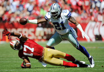 SAN FRANCISCO, CA - SEPTEMBER 18: Braylon Edwards #17 of the San Francisco 49ers falls down before he can catch this pass in front of Mike Jenkins #21 of the Dallas Cowboys in the first quarter during an NFL football game at Candlestick Park on September