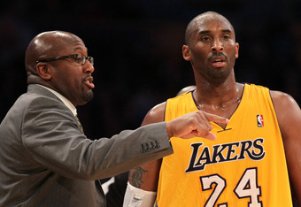 Coach Brown chats with Kobe Bryant.