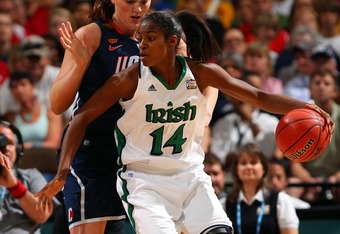 DENVER, CO - APRIL 01:  Devereaux Peters #14 of the Notre Dame Fighting Irish posts up in the second half against Stefanie Dolson #31 of the Connecticut Huskies during the National Semifinal game of the 2012 NCAA Division I Women's Basketball Championship