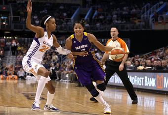 PHOENIX, AZ - SEPTEMBER 03:  Candace Parker #3 of the Los Angeles Sparks drives the ball past DeWanna Bonner #24 of the Phoenix Mercury during the WNBA game at US Airways Center on September 3, 2011 in Phoenix, Arizona.  NOTE TO USER: User expressly ackno