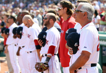 BOSTON, MA - APRIL 16:  Manager Bobby Valentine of the Boston Red Sox lines up with his players for the national anthem bfore the game against the Tampa Bay Rays on April 16, 2012 at Fenway Park in Boston, Massachusetts. The Tampa Bay Rays defeated the Bo