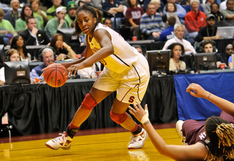 INDIANAPOLIS, IN - APRIL 3:  Nnemkadi Ogwumike #30 of the Stanford Cardinal controls the ball against the Texas A&M Aggies during the 2011 NCAA Women's Final Four at Conseco Fieldhouse on April 3, 2011 in Indianapolis, Indiana.  (Photo by Jamie Sabau/Gett