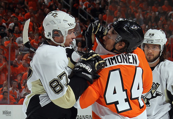PHILADELPHIA, PA - APRIL 15: Sidney Crosby #87 of the Pittsburgh Penguins and Kimmo Timonen #44 of the Philadelphia Flyers square off in Game Three of the Eastern Conference Quarterfinals during the 2012 NHL Stanley Cup Playoffs at Wells Fargo Center on A
