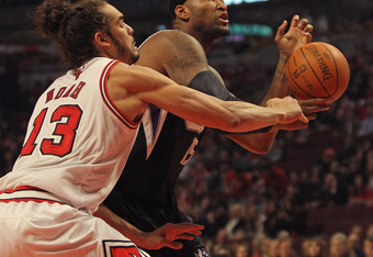 CHICAGO, IL - FEBRUARY 14: Joakim Noah #13 of the Chicago Bulls knocks the ball away from DeMarcus Cousins #15 of the Sacramento Kings at the United Center on February 14, 2012 in Chicago, Illinois. NOTE TO USER: User expressly acknowledges and agrees tha