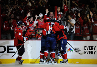 WASHINGTON, DC - APRIL 16:  Alexander Semin #28 celebrates with Alex Ovechkin #8, Brooks Laich #21, and Nicklas Backstrom #19 of the Washington Capitals after scoring a goal against the Boston Bruins in the first period of Game Three of the Eastern Confer