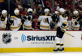 WASHINGTON, DC - APRIL 16:  Zdeno Chara #33 of the Boston Bruins celebrates after scoring a goal against the Washington Capitals during the third period of Game Three of the Eastern Conference Quarterfinals during the 2012 NHL Stanley Cup Playoffs at Veri