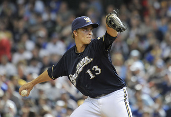 MILWAUKEE, WI - APRIL 7:   Starting pitcher Zack Greinke #13 of the Milwaukee Brewers delivers during the first inning against the St. Louis Cardinals at Miller Park on April 7, 2012 in Milwaukee, Wisconsin.  Photo by Brian Kersey/Getty Images)