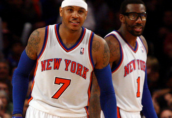 NEW YORK, NY - MARCH 20:  (L-R) Carmelo Anthony #7 and Amare Stoudemire #1 of the New York Knicks react on court in the second half against the Toronto Raptors at Madison Square Garden on March 20, 2012 in New York City.  NOTE TO USER: User expressly ackn