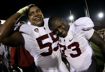 LOS ANGELES, CA - OCTOBER 29:  Offensive tackles Jonathan Martin #54 and Cameron Fleming #73 of the Stanford Cardinal celebrate after the game with the USC Trojans at the Los Angeles Memorial Coliseum on October 29, 2011 in Los Angeles, California. Stanfo