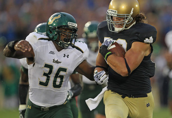 SOUTH BEND, IN - SEPTEMBER 03: Tyler Eifert #80 of the Notre Dame Fighting Irish is pursued by Sam Barrington #36 of the University of South Florida Bulls at Notre Dame Stadium on September 3, 2011 in South Bend, Indiana. (Photo by Jonathan Daniel/Getty I