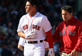BOSTON, MA - APRIL 13:  Jacoby Ellsbury #2 of the Boston Red Sox is helped off the field was injured in a double play in the bottom of the fourth inning against the Tampa Bay Rays during the home opener on April 13, 2012 at Fenway Park in Boston, Massachu