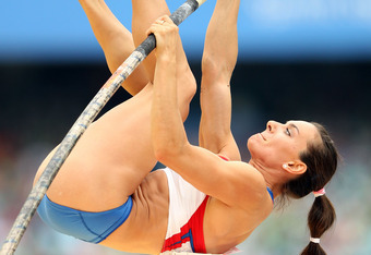 DAEGU, SOUTH KOREA - AUGUST 28:  Elena Isinbaeva of Russia competes in the women's pole vault qualification round during day two of the 13th IAAF World Athletics Championships at the Daegu Stadium on August 28, 2011 in Daegu, South Korea.  (Photo by Ian W