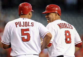 ANAHEIM, CA - APRIL 16:  Kendrys Morales #8 of the Los Angeles Angels reacts with Albert Pujols #5 after his three run homerun against the Oakland Athletics during the first inning at Angel Stadium of Anaheim on April 16, 2012 in Anaheim, California.  (Ph