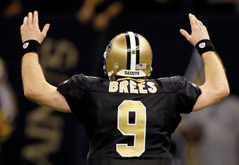 NEW ORLEANS, LA - JANUARY 07:   Drew Brees #9 of the New Orleans Saints celebrates after throwing a touchdown pass to Robert Meachem #17 in the fourth quarter against the Detroit Lions during their 2012 NFC Wild Card Playoff game at Mercedes-Benz Superdom