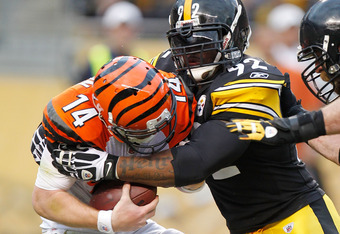 PITTSBURGH, PA - DECEMBER 04:  Andy Dalton #14 of the Cincinnati Bengals is sacked in the fourth quarter by James Harrison #92 of the Pittsburgh Steelers at Heinz Field on December 4, 2011 in Pittsburgh, Pennsylvania. Pittsburgh won the game 35-7. (Photo
